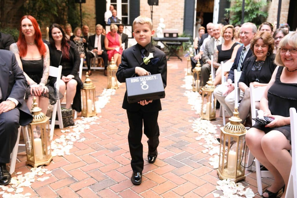 "The ring bearer walks down the aisle with the rings in a briefcase labeled ""Ring Security"""