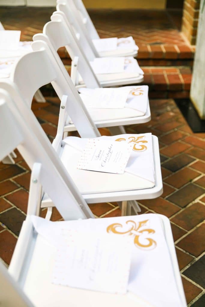 Programs and second line handkerchiefs on guest chairs.