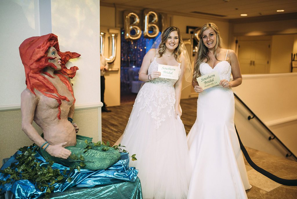 Models From Southern Bridal Dreams Pose With One Of The Life Size Mermaids Mardi
