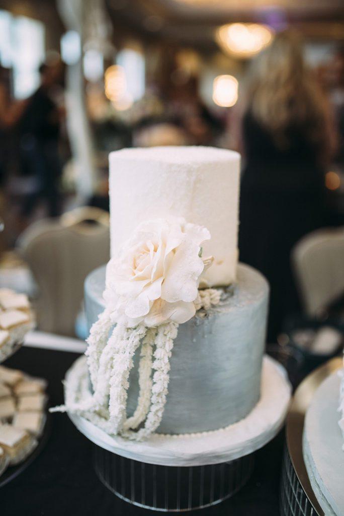 Gambino's Bakery White and silver wedding cake.