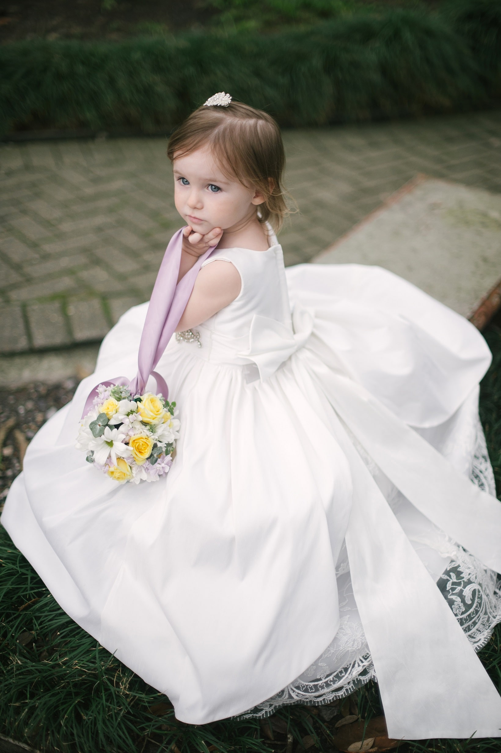 Flower girl with flower ball by Grow With Us Florist.