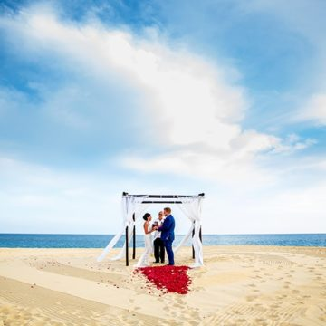 Candice and Matthew say their vows on the beach in Cabo.