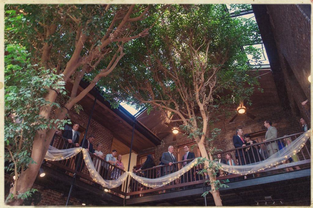 Wedding guests on Rosy's Jazz Hall atrium balcony. photo: Julia Bailey