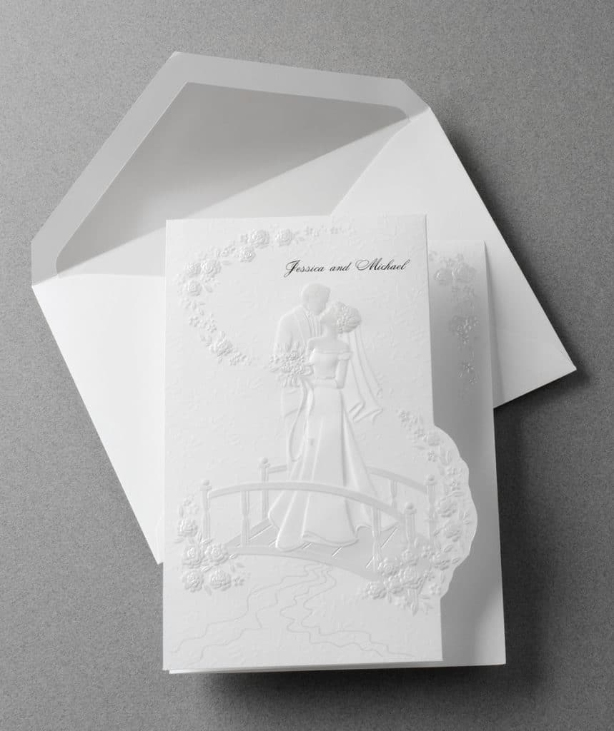 All white embossed wedding invitation by Abbey Printing.