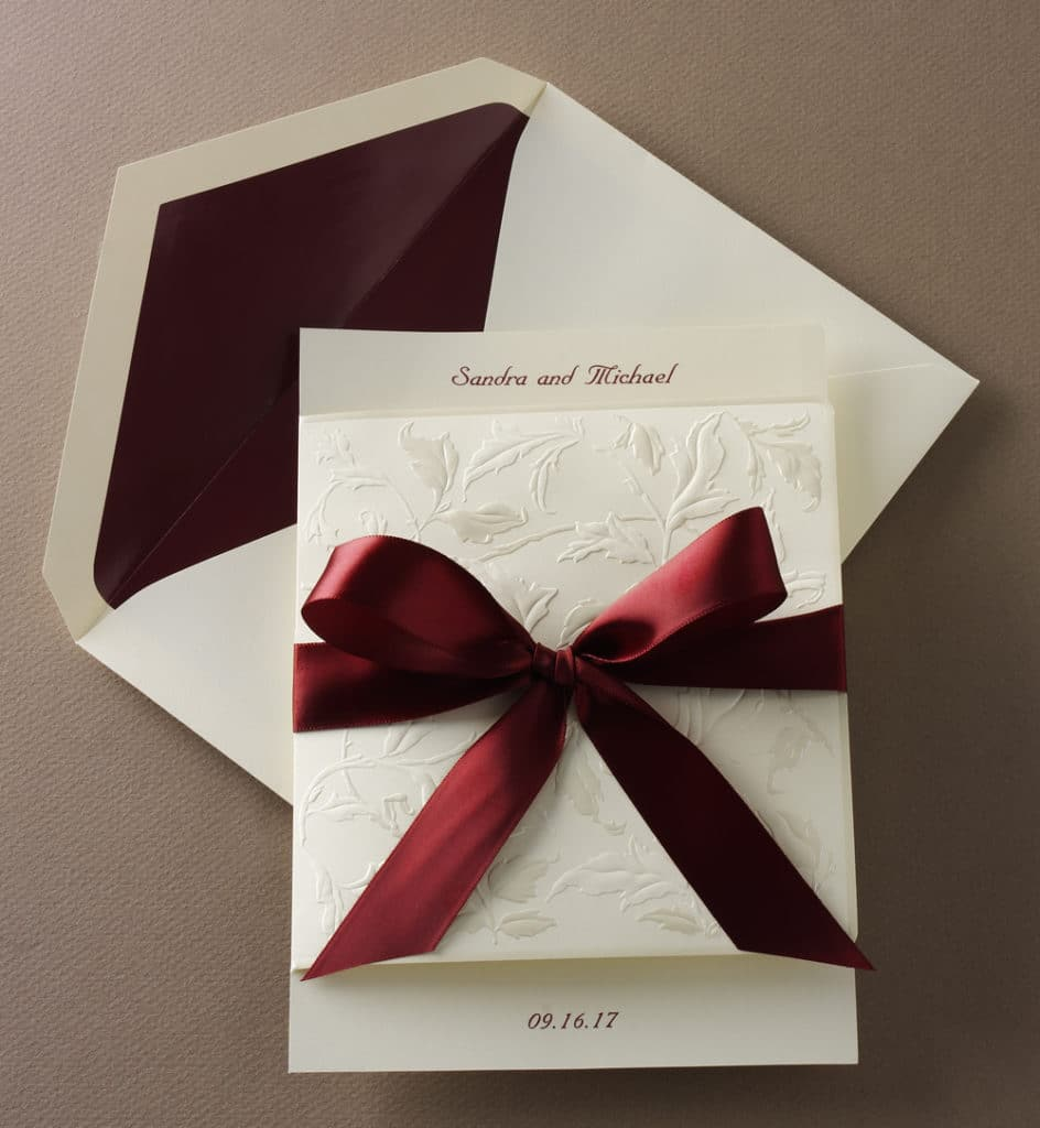 Wedding invitation with burgundy satin ribbon by Abbey Printing.