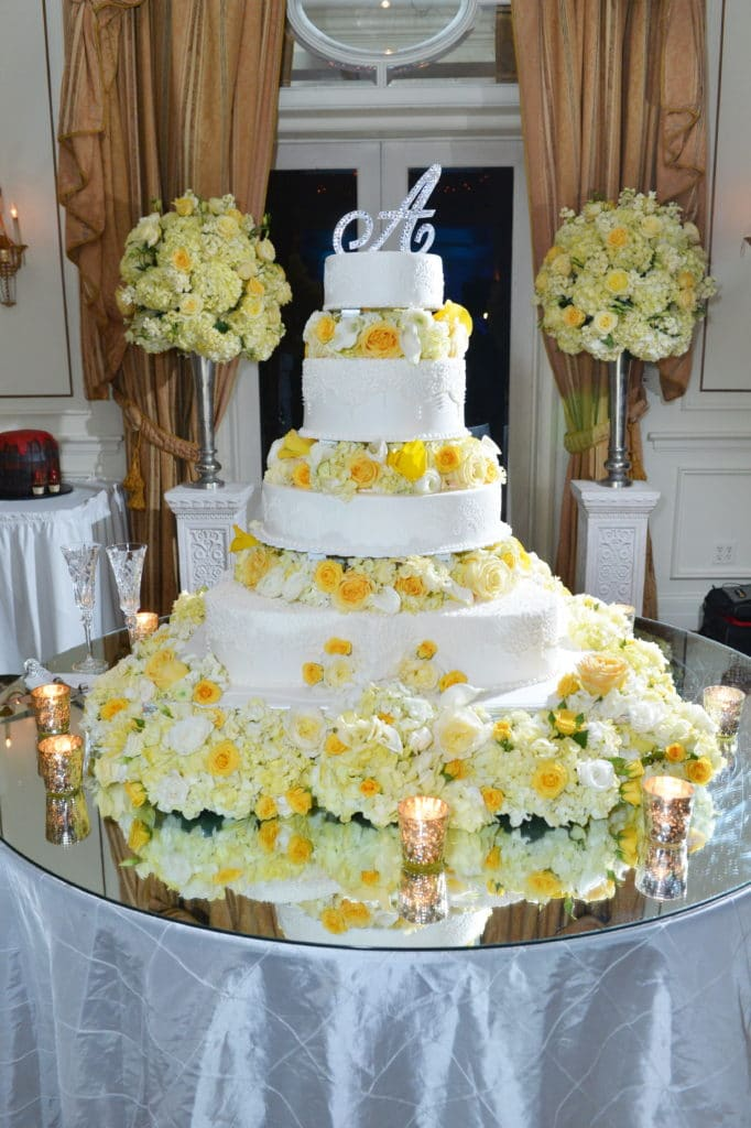 White Wedding Cake With Yellow Flowers By Haydel's Bakery