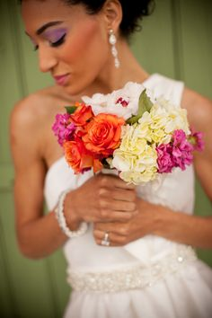 Colorful wedding bouquet by Grow With Us Florist.