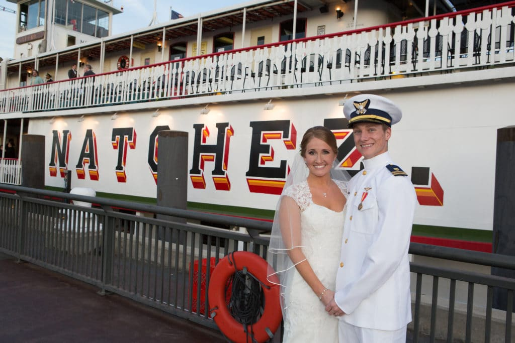 A bride and groom pose beside the Steamer Natchez. Photo: Images by Robert T