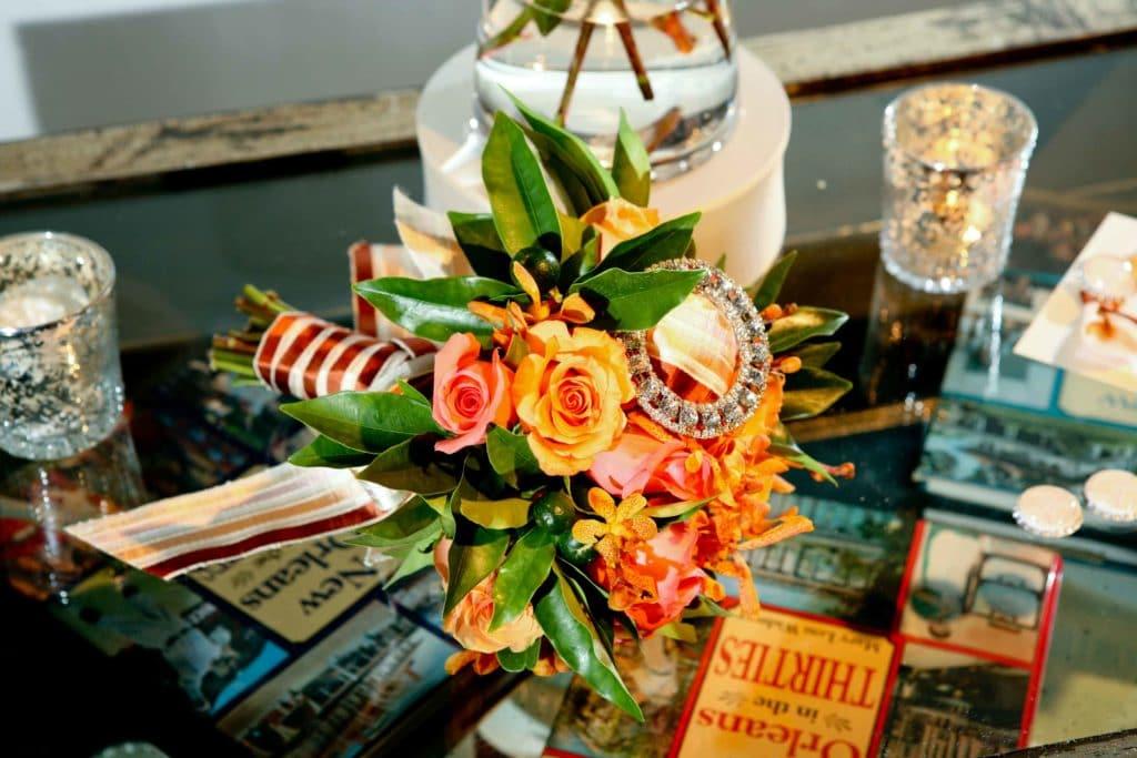 Orange bride bouquet by Grow With Us Florist.
