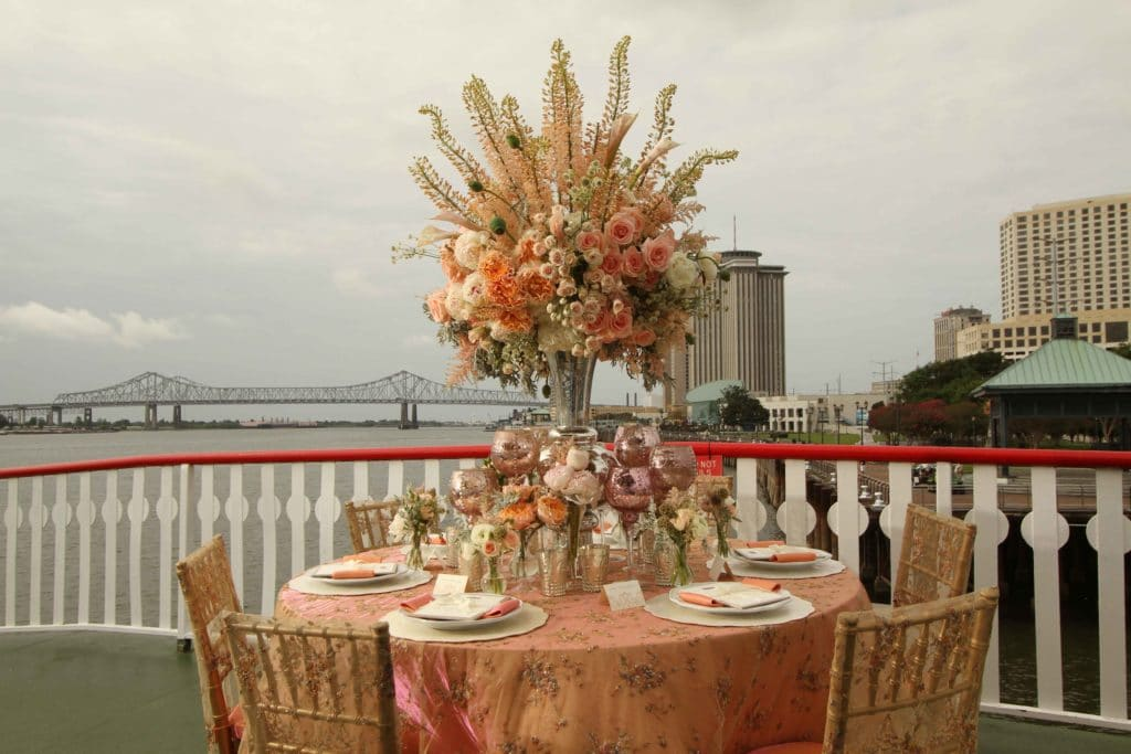 A wedding reception table on the deck of the Steamer Natchez. Photo: Jessica The Photographer