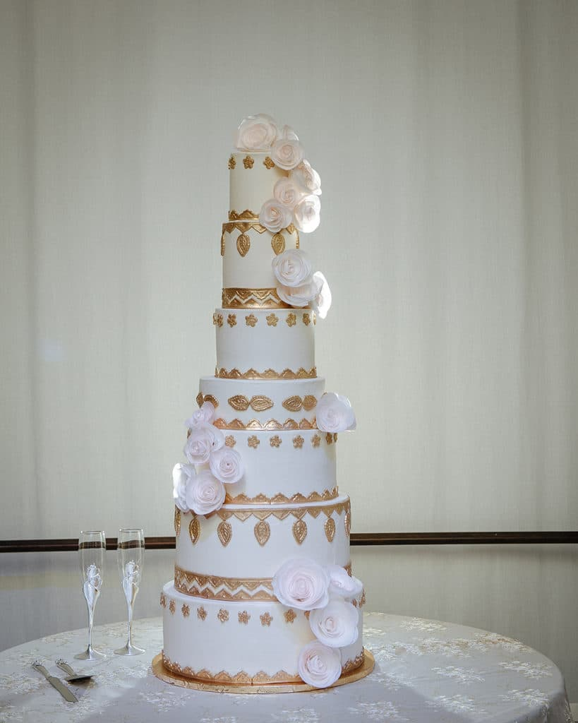 Harry only eats red velvet cake, so Dewanna made sure their 7-tier wedding cake had red velvet and chocolate layers in addition to the the traditional wedding cake flavor. Cake by Kupcake Factory | Photo by Prince Photography