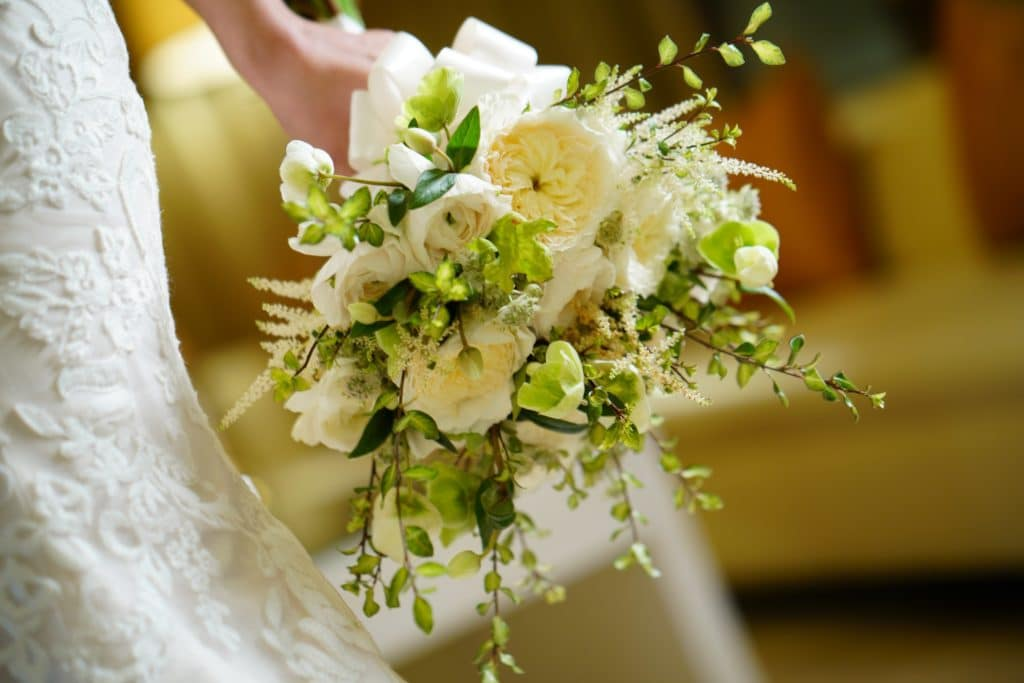 White and green bride bouquet by Grow With Us Florist.