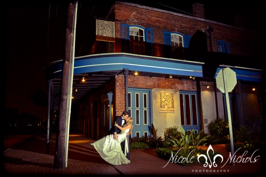 A bride and groom kiss outside of Rosy's Jazz Hall. Photo: Nicole Nichols
