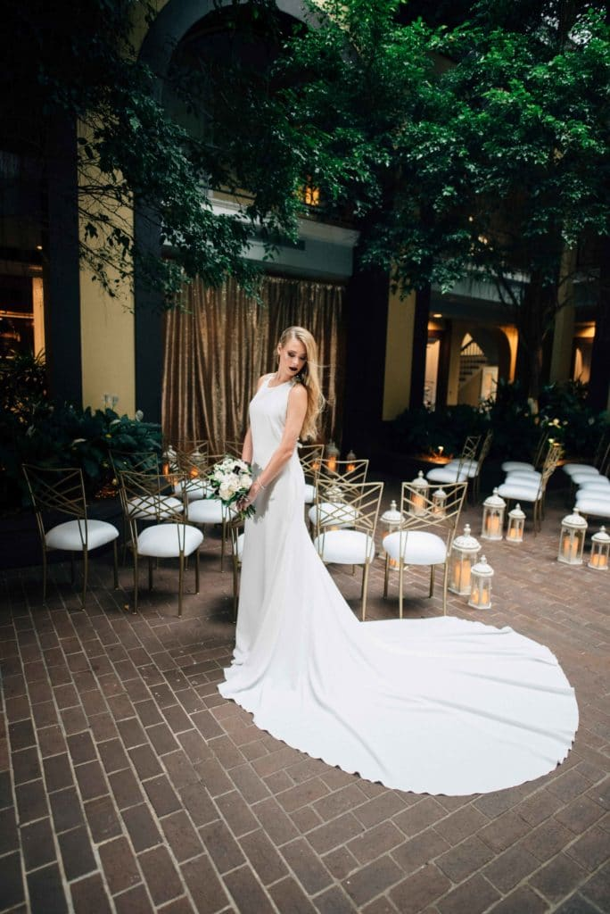 A bride in the courtyard of Hotel Mazarin. Photo: Gabby Chapin Photography