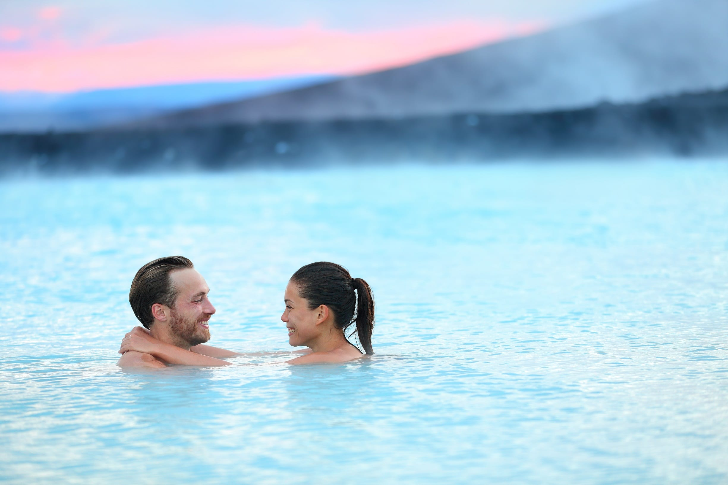 A couple on their honeymoon swim in the ocean. Photo: Shutterstock