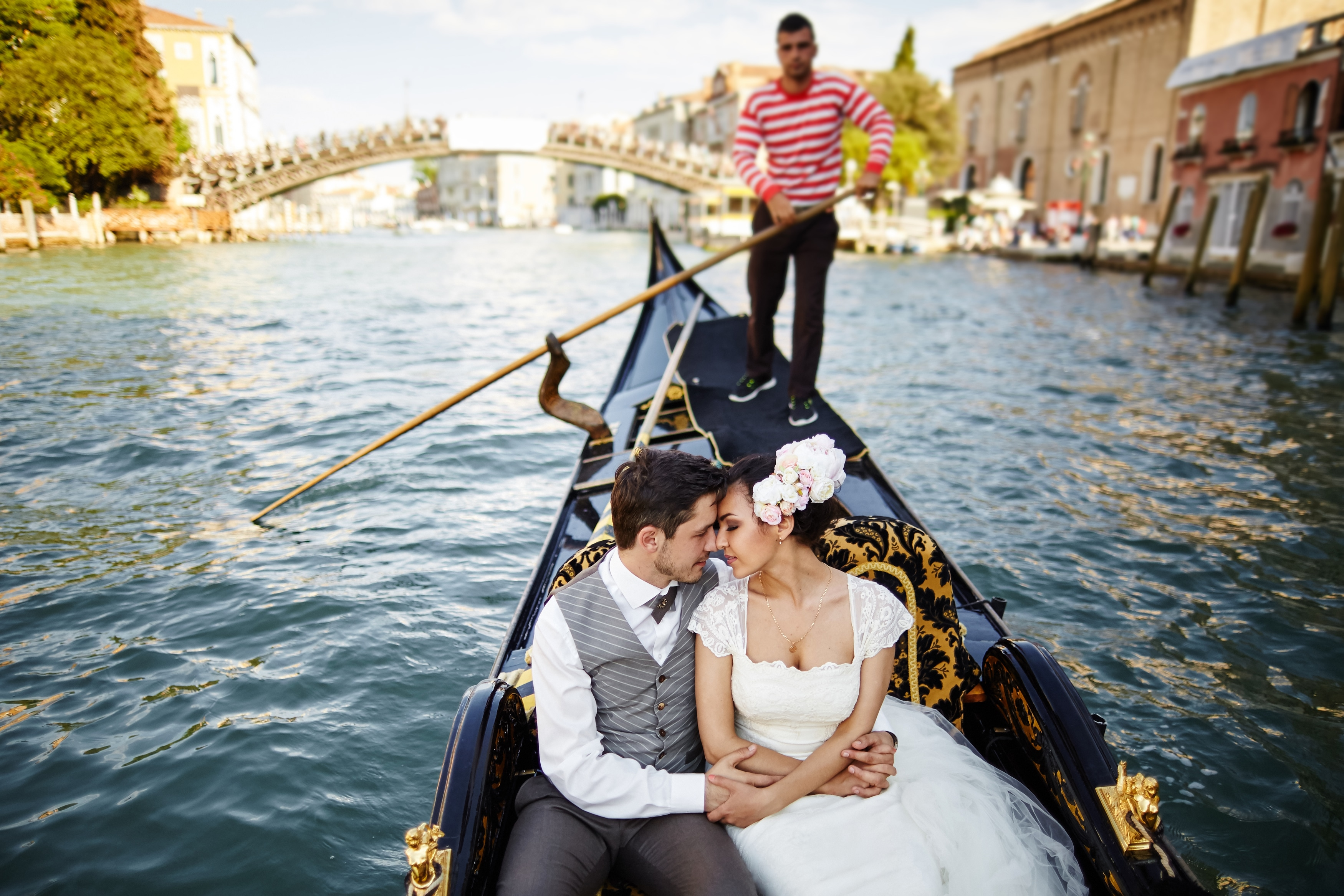 Newlyweds on a gondola in Italy. Photo: Shutterstock