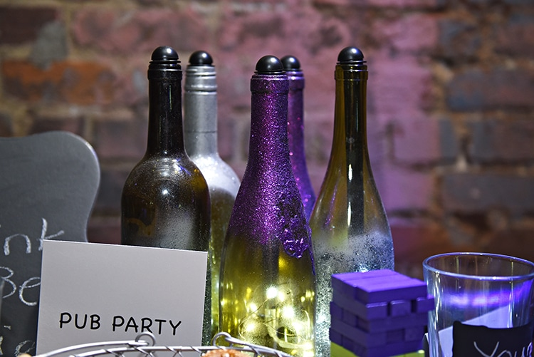 Glittered wine bottles with lights