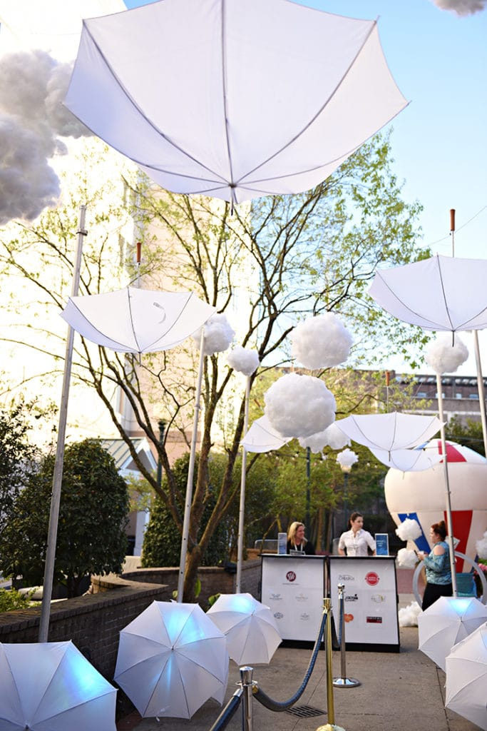 "Umbrellas and cloud lanterns, as envisioned by Belladeux Event Design, ""float"" over the courtyard entrance to <a href="