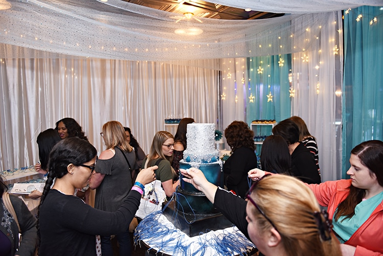 Brides at the Something Blue Bridal Event participate in a ribbon pull for prizes.