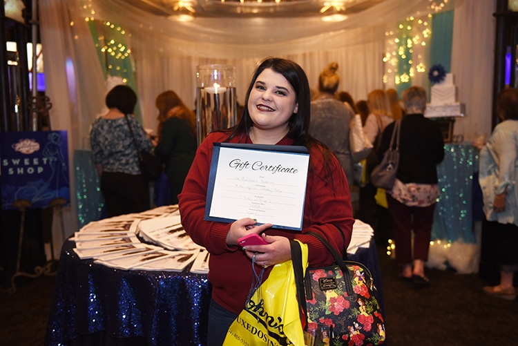 Prize winner from the Cake Pull for Prizes at the Something Blue Bridal Event.