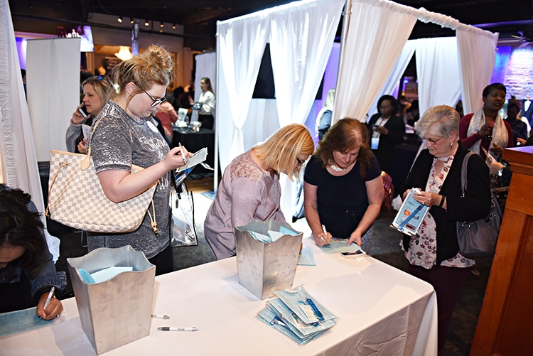 Guests enter for prizes at the Something Blue Bridal Event
