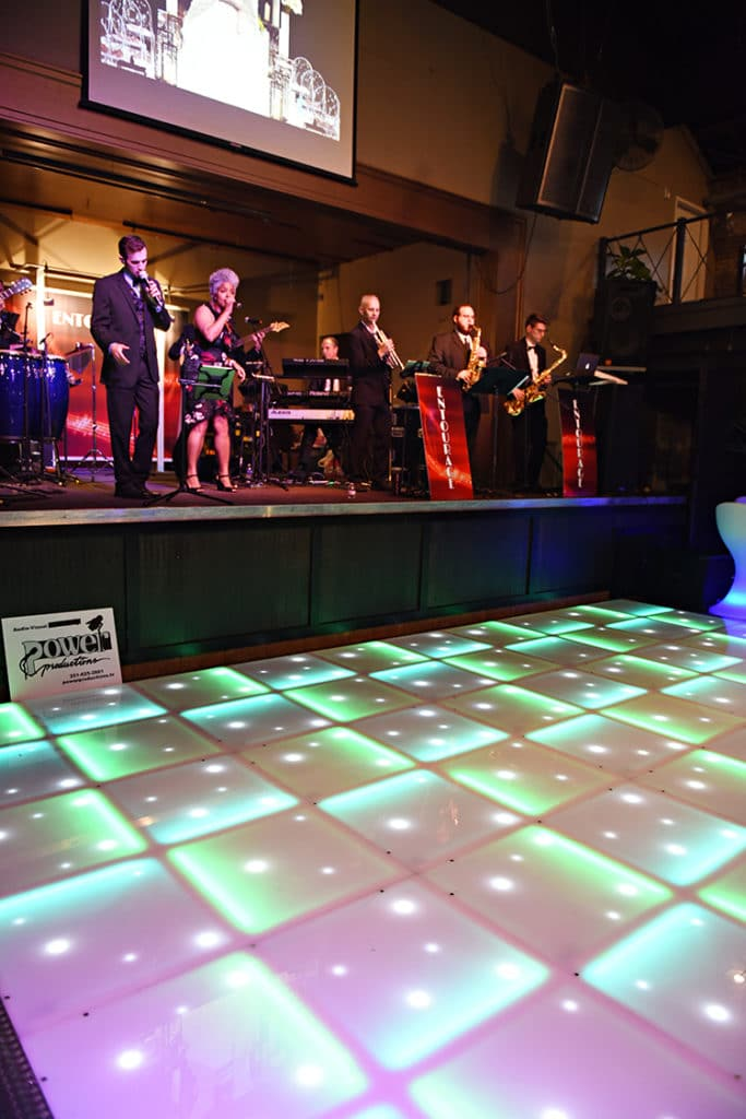 One of the highlights of the show was the illuminated LED Dance Floor in the Big Room from our sponsor Power Productions. The dance floor looked amazing in front of the stage. Entourage Band performed throughout the show keeping the mood fun and upbeat!