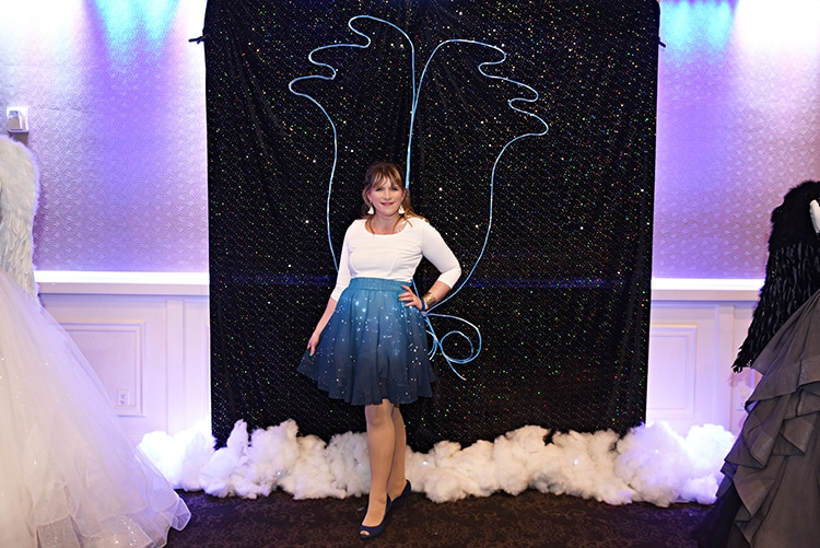 "Guests had fun posting with the ""neon"" angel wings photo opp at the show."
