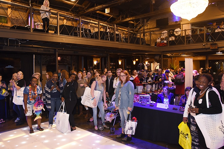 Guests gather for prize drawings at the close of the Something Blue Bridal Event