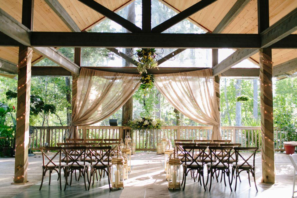 The covered porch at Palmettos on the Bayou set for an intimate wedding ceremony.