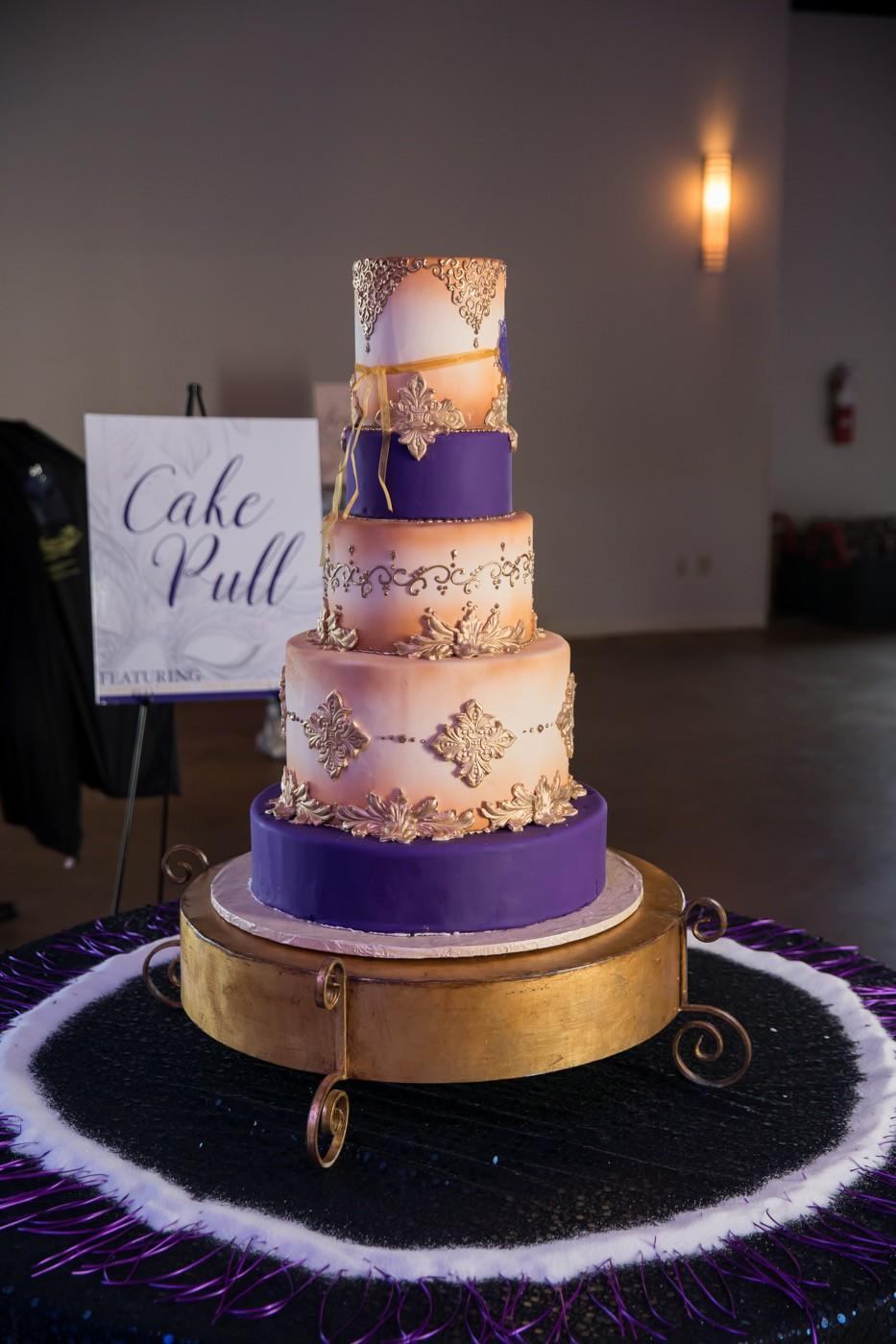 Gambino's Bakery purple and gold mardi gras wedding cake. Photo: Brian Jarreau Photography