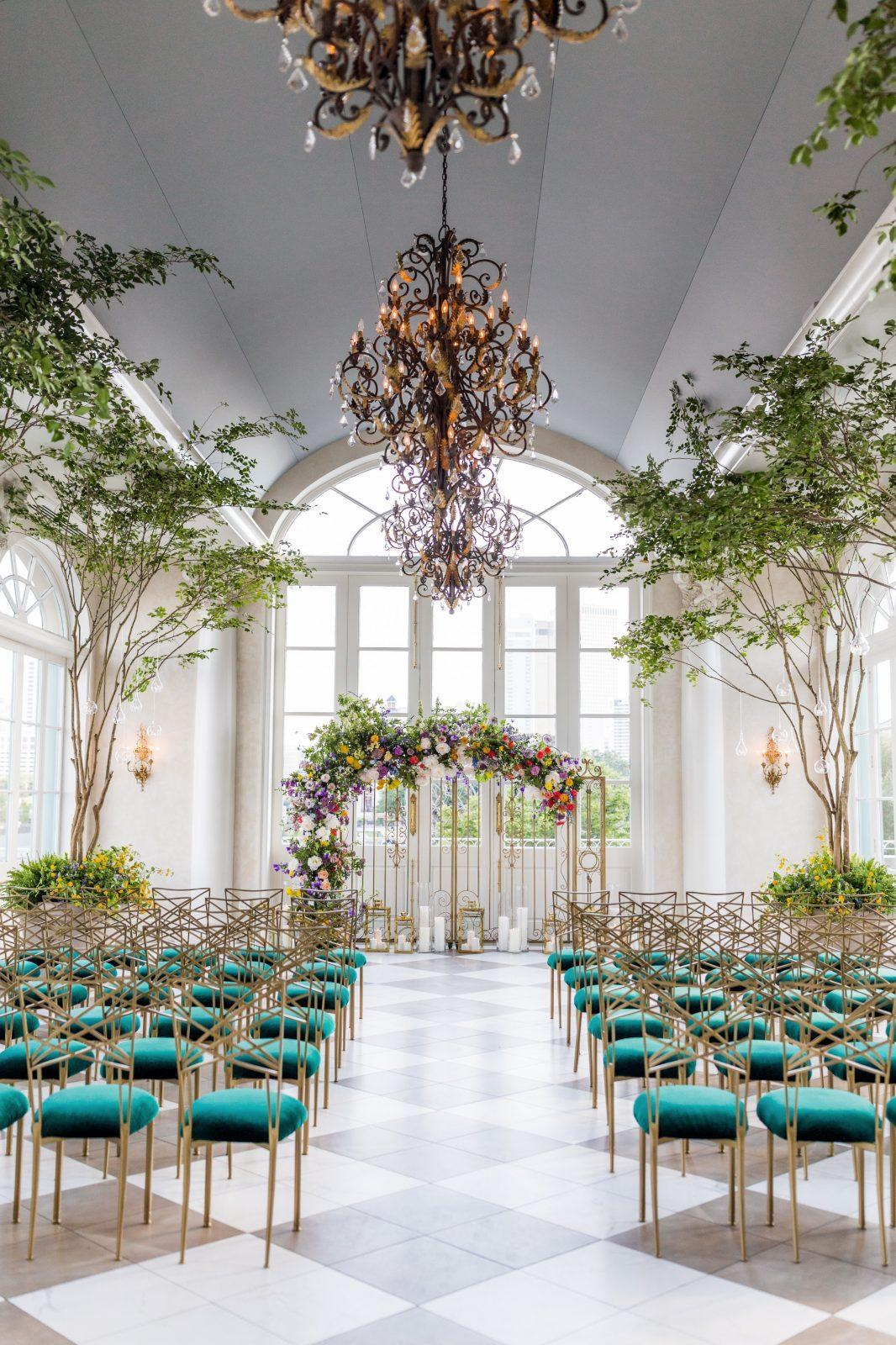Wedding Ceremony set at Marche with True Value Rental Chameleon Chairs with green cushions. Photo by: Aislinn Kate Photography