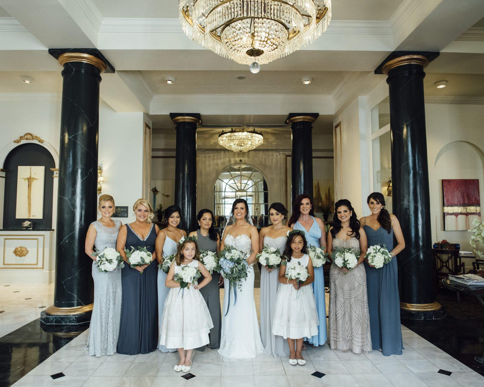 A bride and bridesmaids in the lobby of the Bourbon Orleans Hotel. Photo: Gabby Chapin Photography