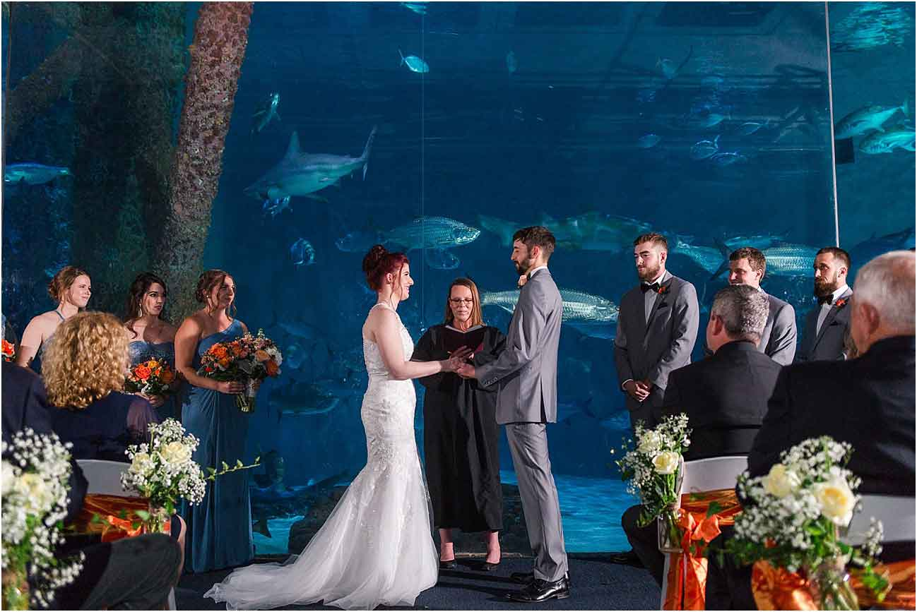 Wedding ceremony at The Aquarium of the Americas. Photo: Studio Tran.