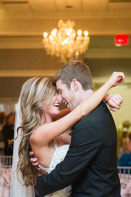 A bride and groom dance at their wedding. Photo: Catherine Guidry