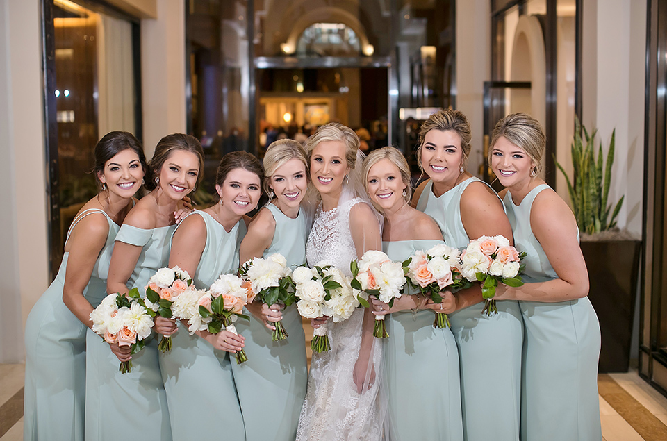 A bride and her bridesmaid pose for a photo before the wedding. Photo: Secondline Photography
