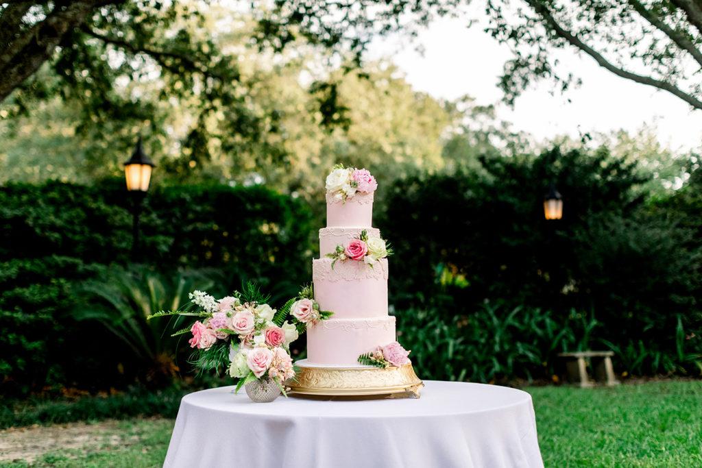 Blush, four-tier vegan wedding cake by Shake Sugary.