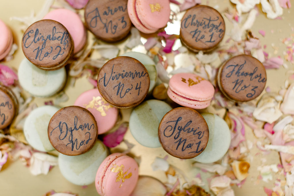 Vegan macaron escort cards by Grey Bird Baking Company featuring calligraphy by Eglantine Rose Letterpress.