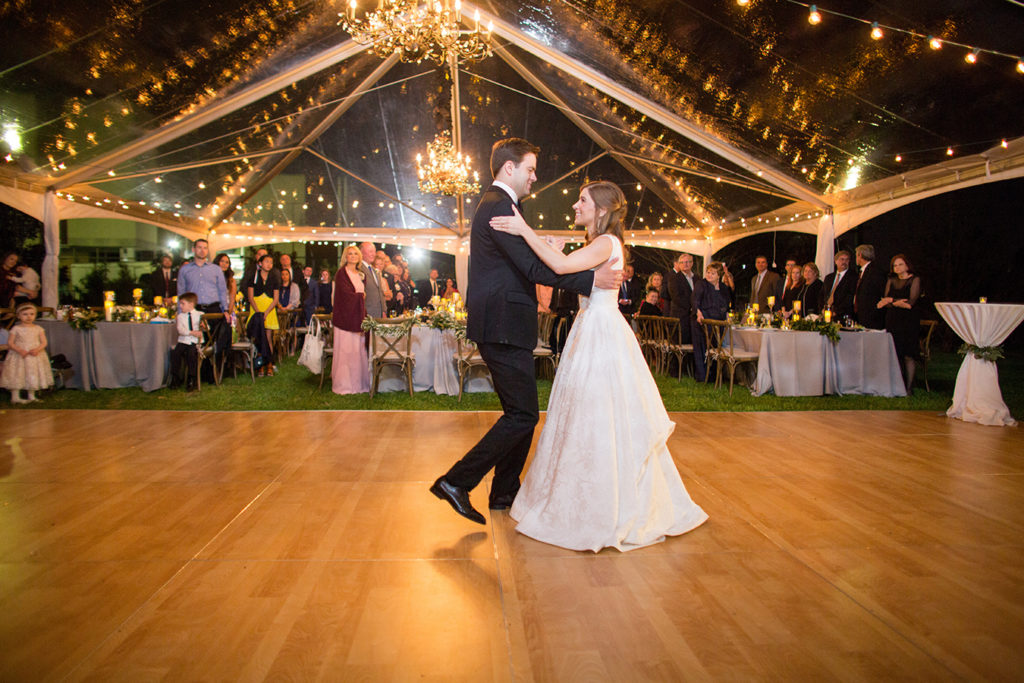 Wedding first dance under a clear tent | photo by Rob Garland Photography