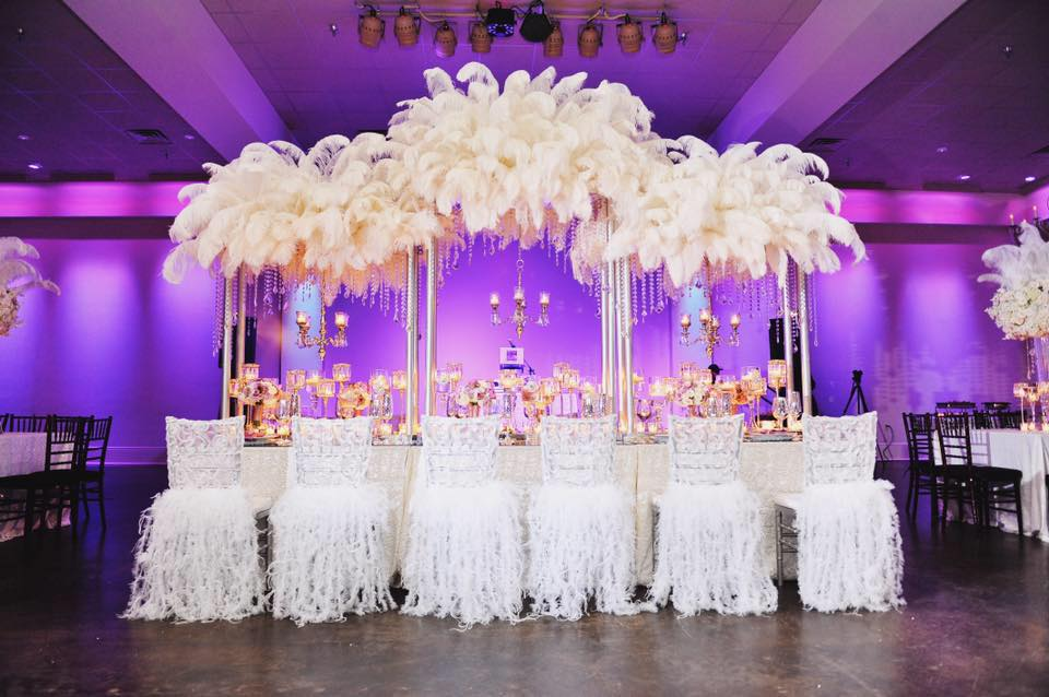 A luxurious white feather decorated reception table at The Cannery. Photo: Studio Tran