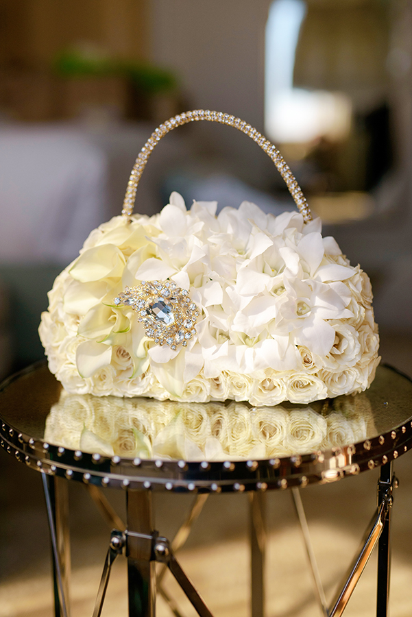 "Doliecha's bridesmaid carried a stunning floral ""purse"" created by Bella Blooms."