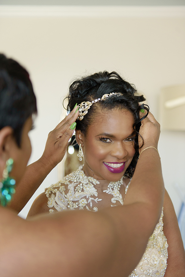 Doliecha's bridesmaid adjusts her bridal headpiece before the wedding.