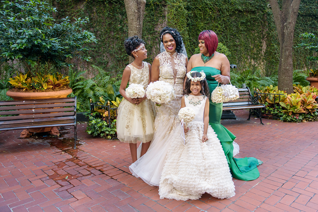 Doliecha and her bridesmaids in the courtyard at Windsor Court Hotel in New Orleans