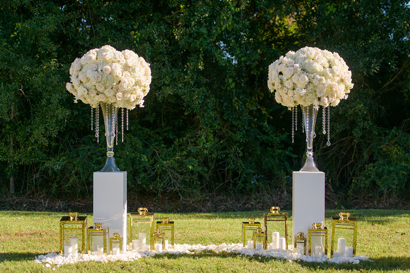 The ceremony altar included large floral arrangements, gold lanterns and rose petals.