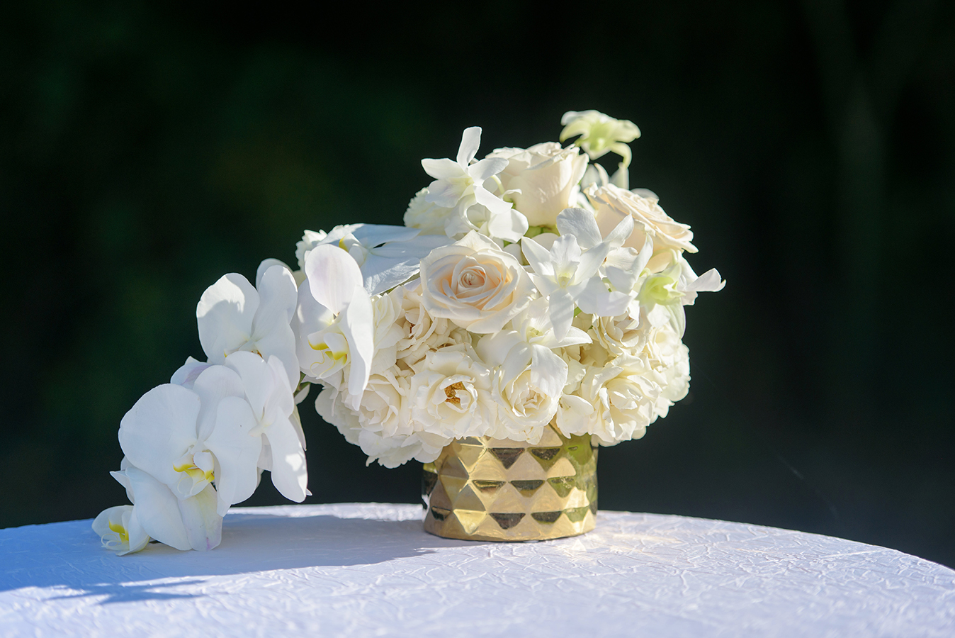 Floral arrangements included ivory roses and phaelaenopsis orchids