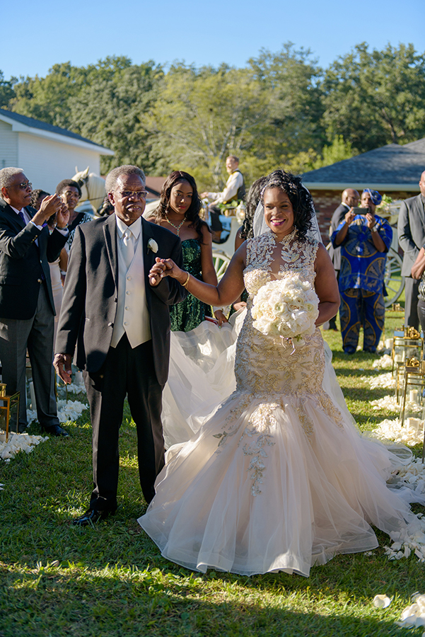 "Doliecha walked down the aisle to a rendition by a professional vocalist of ""I'm wishing on a Star"" written by Rolls Royce. The couple said their marriage vows in an outdoor ceremony in front of 200 of their closest friends and family."