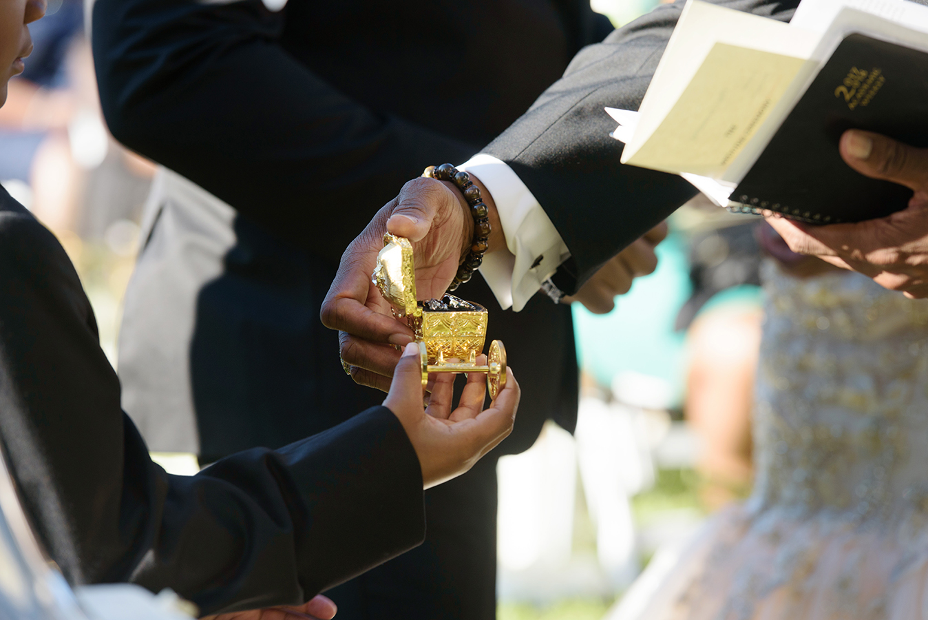 The wedding rings were held in a gold ring box in the shape of a fairy tale carriage.