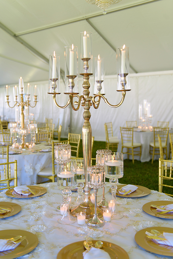 Gold candelabra grace each table at the tented reception.