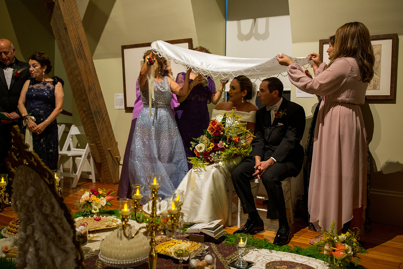During the ceremony, happily married women grinded sugar over Susan and Richard's heads and the couple fed each other honey off of their pinkies in front of all the guests.