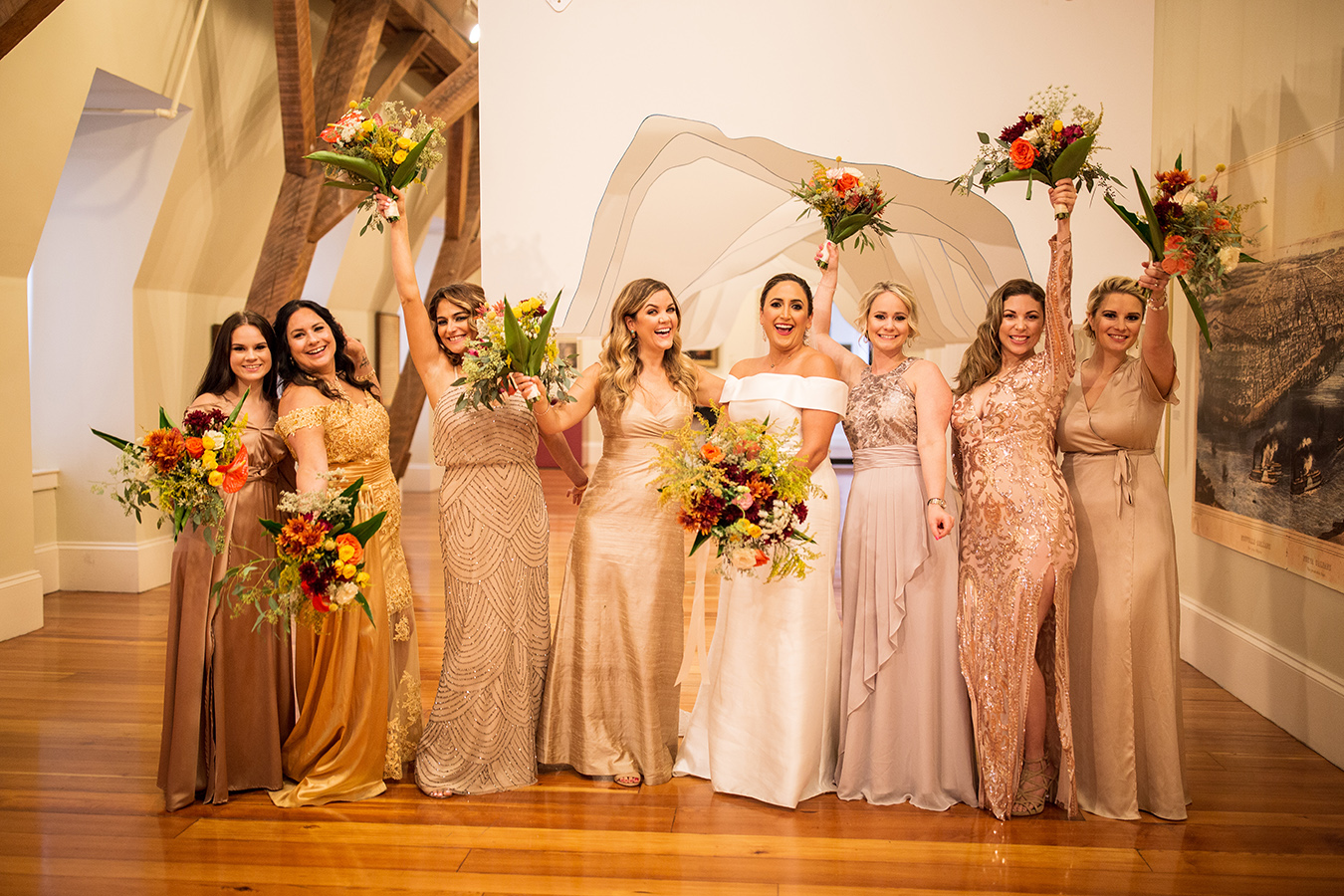 Susan's bridesmaids each wore a different style dress within a warm golden and blush color palette.