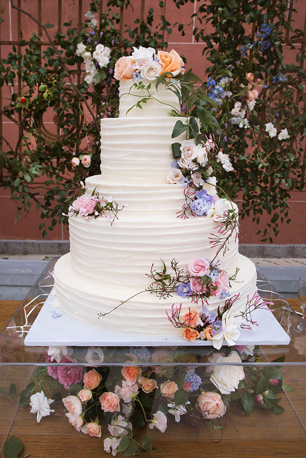 Wedding cake by Flour Power Confectionery with fresh flower decorations by Mitch's Flowers